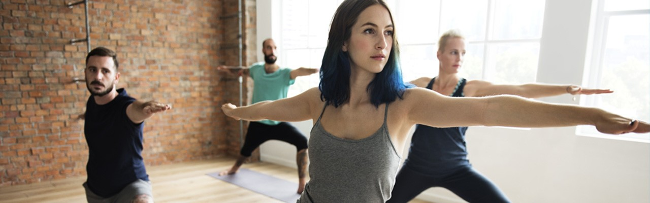group of people taking a yoga class