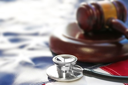 gavel-next-to-american-flag-and-stethoscope