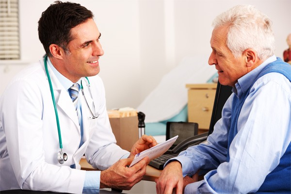 Doctor reviews medical protocols with patient